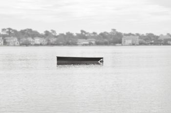 Little boat on the water - black and white photography • Creative Lune